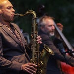 The 2014 Detroit Jazz Festival artist in residence Joshua Redman performs with Bad Plus during the opening night of the 35th Annual Detroit Jazz Festival on Friday August 29, 2014, at Cadillac Square in downtown Detroit.