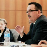 Colorado Commissioner Dick Wolfe, right, asks a question Thursday during the Rio Grande Compact Commission's annual meeting in Santa Fe, N.M.. Commissioners heard from federal experts about the challenges water managers will face due to the effects of drought on the Rio Grande.