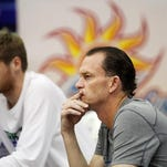 FGCU head coach Joe Dooley, center, watches the team warm-up before taking on Stetson on March 4 at Alico Arena.