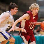 Simms' Erik Pscherning (10) tries to get by Highwood's Jacob Malek Wednesday during Northern C Divisional tournament action at the Four Season Arena. TRIBUNE PHOTO/LARRY BECKNER