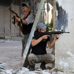 Rebel fighters hold a position on a front line Wednesday in the Damascus suburb of Yalda in Syria.