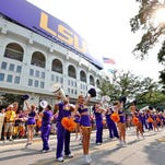 LSU Tigers cheerleaders perform for fans on the street outside Tiger Stadium prior to kickoff against the UAB Blazers last season.