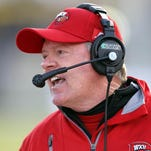 WKU coach Bobby Petrino signed 10 junior college transfers Wednesday, the school announced.