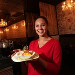 Waitress Nicole Castro of Dover holds the striped bass ceviche at Havana Koi in Morristown, a Cuban-Asian fusion restaurant.