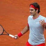 Roger Federer reacts after missing a return during his fourth-round match against Ernests Gulbis at the French Open on Sunday in Paris.