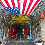 Sgt. Ezra Brown inside an Army cargo helicopter during the Rochester WINGS aviation expo and Fly In in 2010.