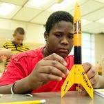 Rashaun Nock of Snow Hill makes the final adjustments to his rocket he created from a kit during a previous STEM program event.