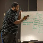 Larry Carroll Jr. of Fenix Youth Project takes notes as attendees share their views of police during the first of the project's Rise to Power events to facilitate a discussion between local law enforcement and the community. <cutline_credit>LAURA EMMONS PHOTO</cutline_credit>