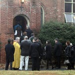 The casket of train derailment victim James Ferrari is carried in to Church of the Divine Love in Montrose Dec. 5, 2013.