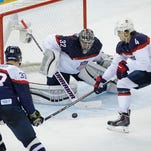 Team USA's Max Pacioretty, left, jumps as a shot comes in between Slovakia's goalie Jaroslav Halak and Slovakia's Rene Vydareny during the first period Thursday in Sochi, Russia.