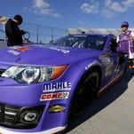 Denny Hamlin exits his car during qualifying Friday.