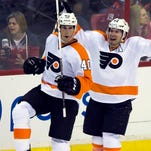Flyers center Vincent Lecavalier (left) celebrates his game-winning goal with teammate Kimmo Timonen. The Flyers defeated the Capitals 5-4.