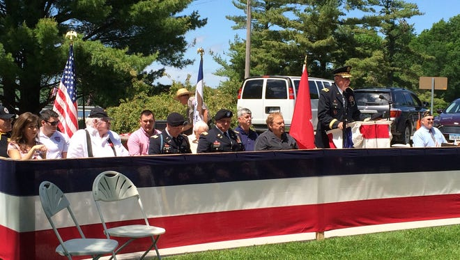 The 11 Johnson County veterans are seated at the start of the Memorial Day ceremony at the Coralville Lake on Monday, May 25. The honorees received a certificate and had their names engraved on trail markers along the Veterans National Recreation Trail at the lake.