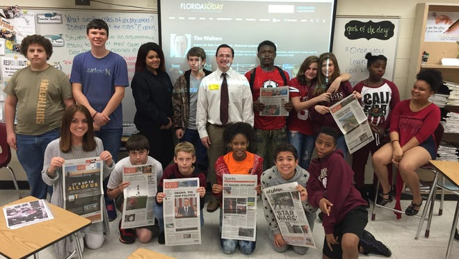 Madison Middle School students and their teacher, Mrs. Dominique Kidd, bottom left, have their picture taken with FLORIDA TODAY's Tim Walters, standing center.