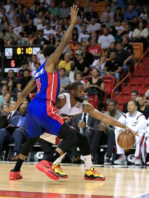 Miami Heat guard Dwyane Wade (3) dribbles the ball as Detroit Pistons guard Kentavious Caldwell-Pope (5) defends in the first half at American Airlines Arena.