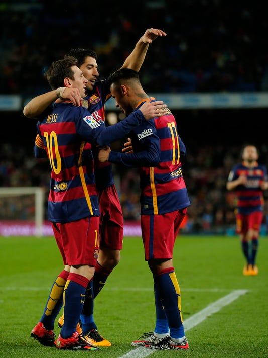 FC Barcelona's Neymar, right, celebrates a goal with his teammates Luis Suarez, center, and Lionel Messi against Celta Vigo during a Spanish La Liga soccer match at the Camp Nou stadium in Barcelona, Spain, Sunday, Feb. 14, 2016. (AP Photo/Manu Fernandez)