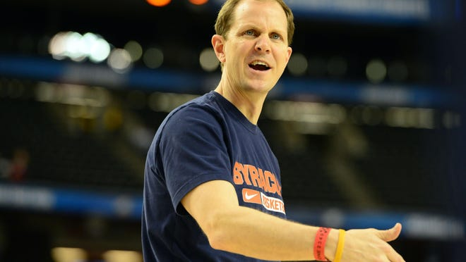 Mike Hopkins, seen here at the 2013 Final Four in Atlanta, has been an assistant on Syracuse's staff for 19 years.