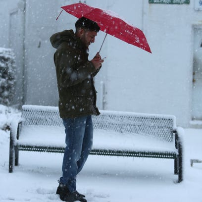 Hasham Khan waits for a bus in the snow on Yonkers