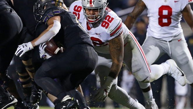 Ohio State defensive tackle Haskell Garrett pursues Northwestern running back Drake Anderson during a game last October.