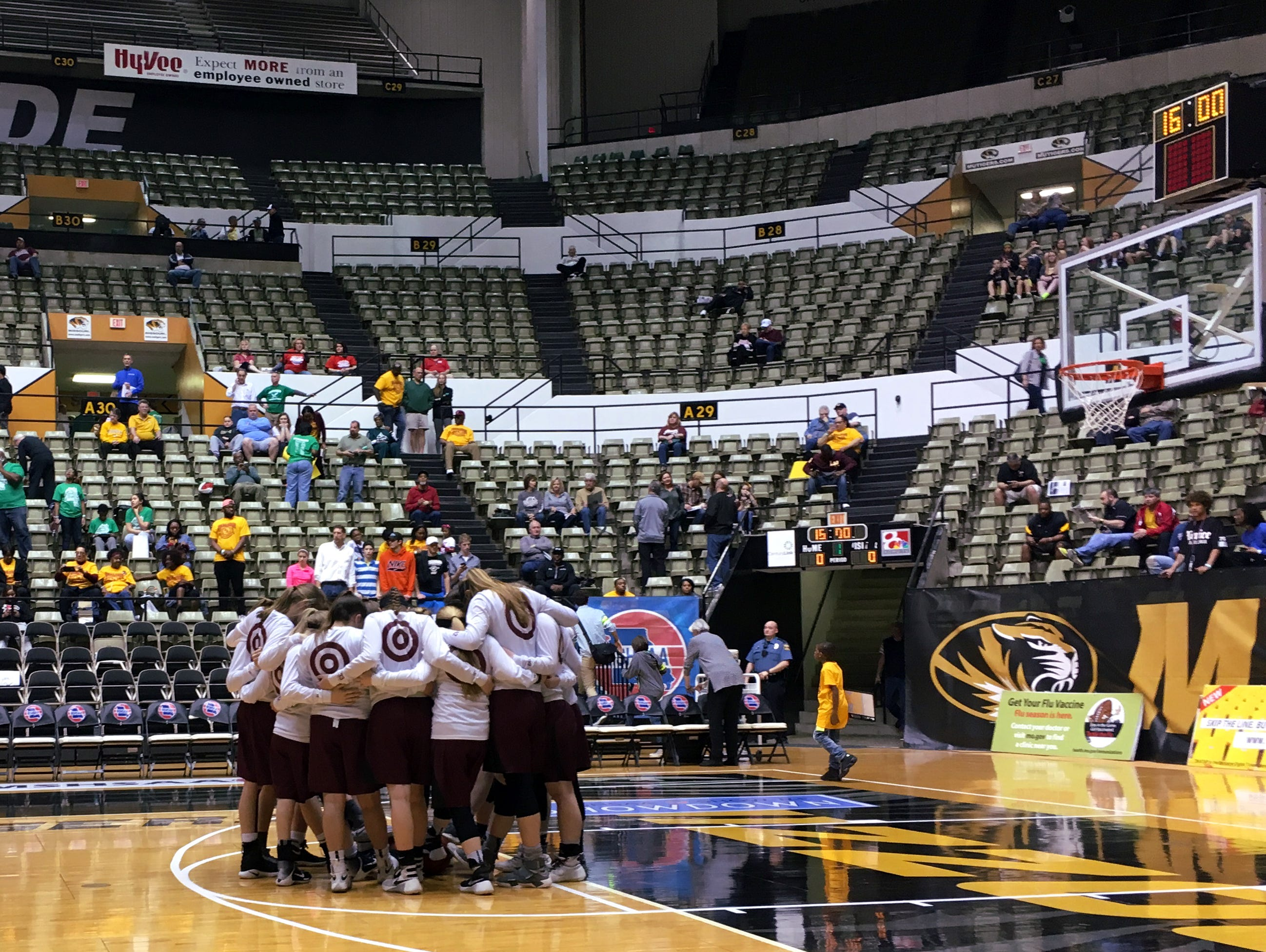 The Strafford High School girls basketball team huddles together moments before a 2017 Class 3 playoff semifinal game against Lutheran North at the Hearnes Center in Columbia.