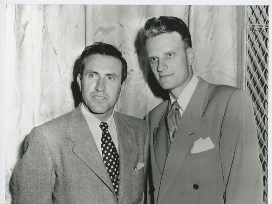 "Louis Zamperini, left, met Billy Graham at the 1949 Los Angeles Crusade, a life-changing encounter re-created in ""Unbroken: Path To Redemption."""