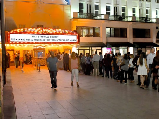 "Over 1,500 people formed a line that snaked its way past the Museum of Art late Friday night, waiting to enter the Plaza Theater to view ""The Man Who Killed Hitler And Then The Bigfoot"" at the Plaza Classic Film Festival."