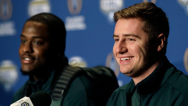 Michigan State quarterback Connor Cook, right, smiles as he sits with teammate wide receiver Aaron Burbridge in December 2015.