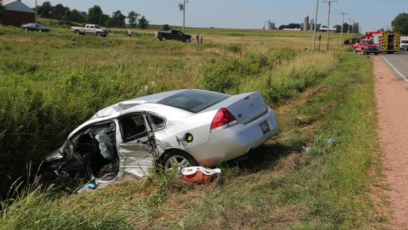 A silver Chevrolet Impala rests in the ditch at the scene of an accident at the intersection of County M and Maple Street, 2 miles south of Rozellville, in the town of Day on Monday, July 27. It collided with a heavy-duty truck, which ended up on its side.