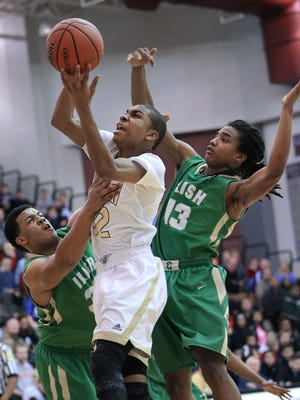 Warren Central's Djimon Henson goes for a shot while being guarded by Cathedral's Jared Thomas, left, and Tra Landers during the IHSAA Boys Basketball Sectional #10 held at Lawrence Central High School on Tuesday, Mar. 3, 2015. Cathedral won 72-65.
