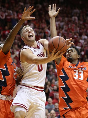 Indiana Hoosiers forward Max Bielfeldt (0) drives between Illinois Fighting Illini guard Aaron Jordan (23),left, and Mike Thorne Jr. (33) in the second half of their game Tuesday, Jan 19, 2016, evening at Assembly Hall in Bloomington IN. The Indiana Hoosiers defeated the Illinois Fighting Illini 103-69.