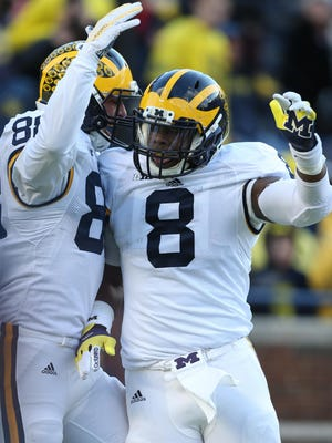"""Jake Butt, left, and Tyrone Wheatley celebrate after a touchdown during Friday's spring game on April 1, 2016 at Michigan Stadium. """"I truly think that we can win it all,"""" Butt said."""