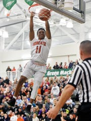 Northeastern's Fred Mulbah dunks in the 2017 YAIAA title game at York College.