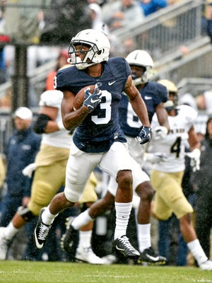 Penn State's DeAndre Thompkins returns a punt for a touchdown in the first half of an NCAA Division I college football game Saturday, Sept. 2, 2017, at Beaver Stadium. Penn State, fresh off a Big 10 Championship win, shut out Akron 52-0 in its season opener.