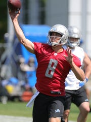 Lions quarterback Matt Cassel goes through drills during