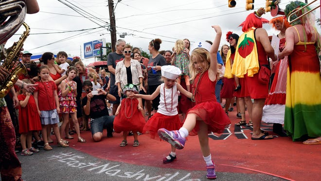 Vivi Rizzo, 4, and Juniper Kelly, 5, dance at the 13th annual Tomato Art Festival in East Nashville on August 13, 2016.