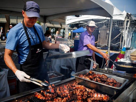 Ken Baccam grills short ribs for the Aroydee booth at The World Food & Music Festival at the Western Gateway Park Friday, Sept. 15, 2017.