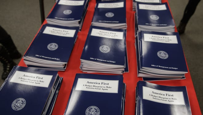 Copies of President Trump's first budget are displayed at the Government Printing Office in Washington on March 16, 2017.