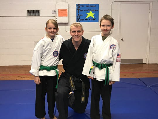 Jason Wesley with two of his students, Issie Evans