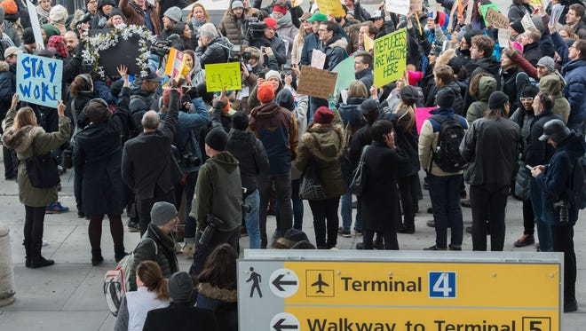Protesters gather at JFK International Airport's Terminal 4 on Jan. 28, 2017, to demonstrate against President Trump's executive order to suspend refugee arrivals.