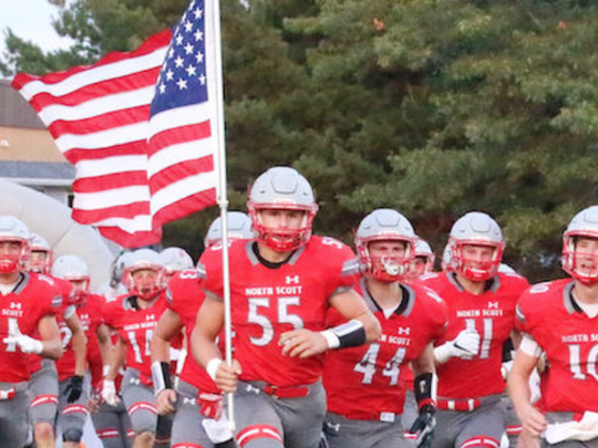 North Scott defensive end Zach Petersen (55) leads his team onto the field before a game vs. Davenport Assumption on August 25, 2017.