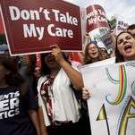 "Jessica Ellis, right, holds a sign that says ""yay 4 ACA,"" as she and other supporters of the Affordable Care Act react with cheers as the opinion for health care is reported outside of the Supreme Court in Washington, Thursday June 25, 2015, in Washington."