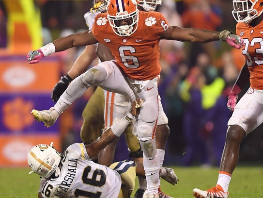 Clemson linebacker Dorian O'Daniel (6) brings down Georgia Tech quarterback TaQuon Marshall (16) during the 4th quarter on Saturday, Oct. 28, 2017 at Clemson's Memorial Stadium.