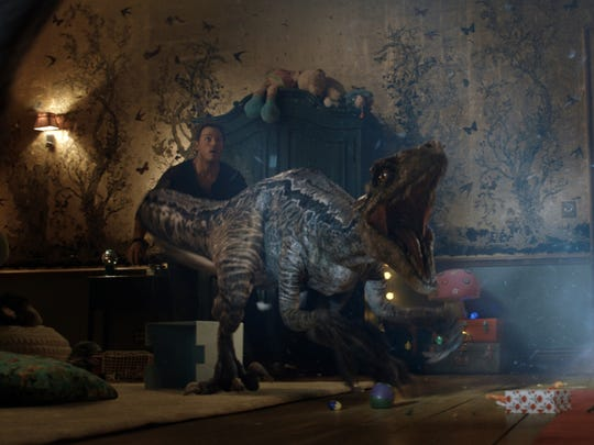 "The loyal velociraptor Blue saves her human buddy Owen (Chris Pratt) in ""Jurassic World: Fallen Kingdom."""