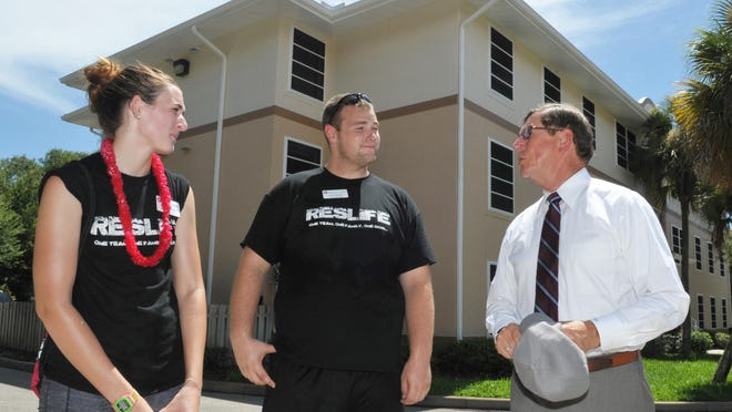Resident assistants McKenzie Clark and Chris Kennedy with Florida Tech President and CEO T. Dwayne McCay, Ph.D. who was meeting with students moving into dorms at Columbia Village housing at Florida Institute of Technology.