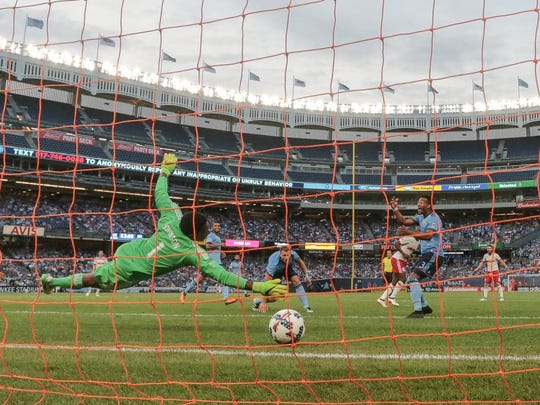 New York City FC goalkeeper Sean Johnson (1) dives