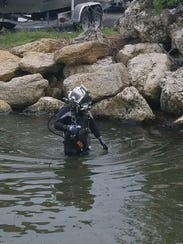 A diver from Logan Marine goes out along the State