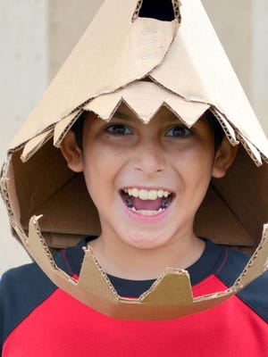 Logan Baeza gave a sharky smile at the Monsoon Puppet Parade booth at the Red Hot Children's Fiesta last year.