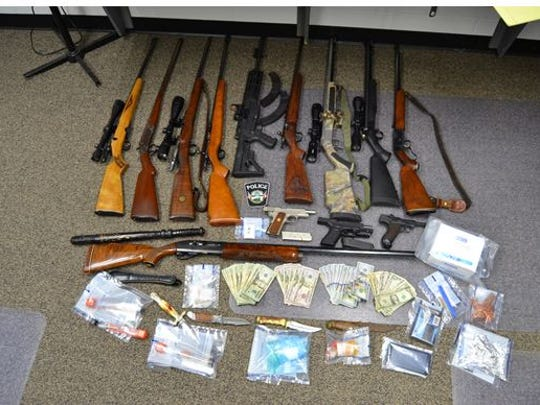 A raid in Crestline Sunday netted cash, methamphetamine, guns, knives, clubs, evidence of heroin and methamphetamine use in the home at 724 Brown St., authorities reported.