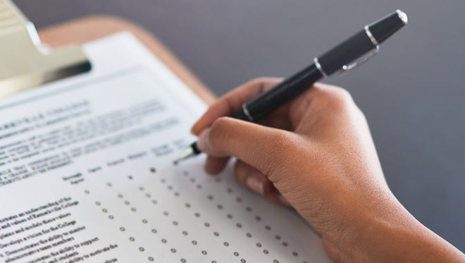 File photo of a person filling in a form