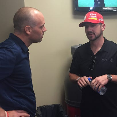 Jeff Blashill and Cup driver  Michael Arnett, driver of the No. 47 Chevrolet, shoot the breeze in MIS media room.